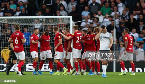 Andreas Weimann of Bristol City celebrates with his team mates after scoring the first goal of the game during the Sky Bet Championship match between...