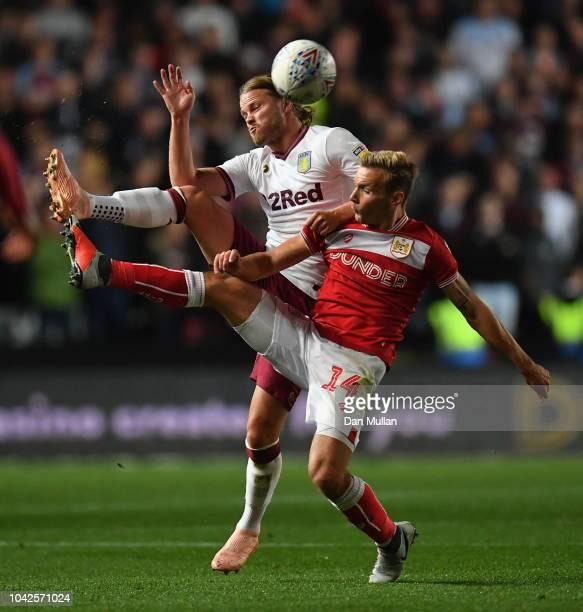 Andreas Weimann of Bristol City is challenged by Birkir Bjarnason of Aston Villa during the Sky Bet Championship match between Bristol City and Aston...