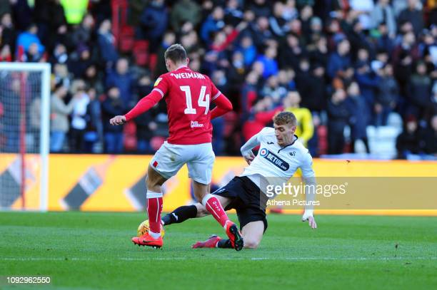 Andreas Weimann of Bristol City is tackled by Jay Fulton of Swansea City during the Sky Bet Championship match between Bristol City and Swansea City...