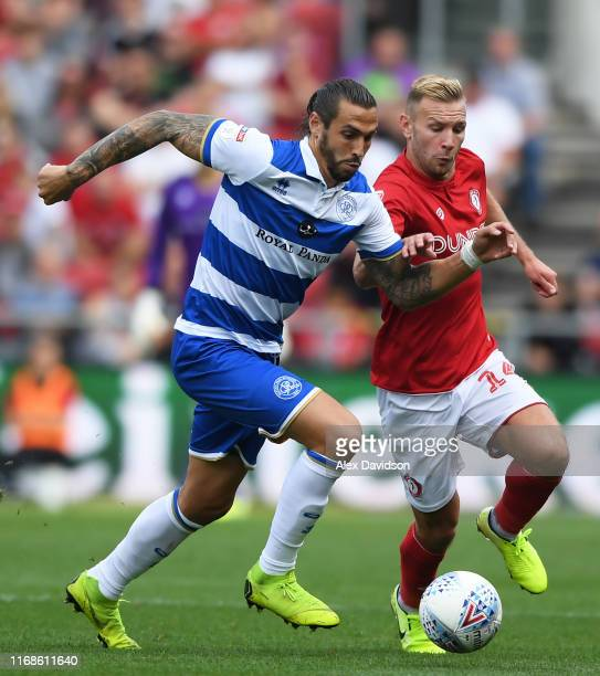 Andreas Weimann of Bristol City tackles Geoff Cameron of Queens Park Rangers during the Sky Bet Championship match between Bristol City and Queens...