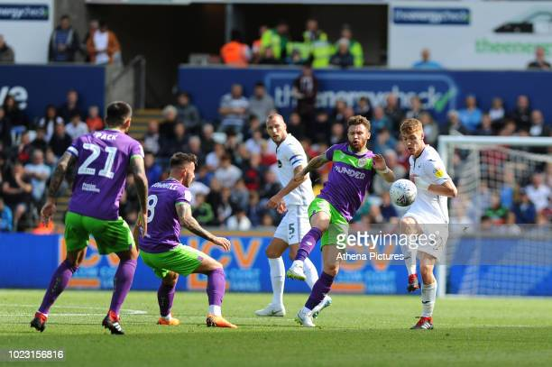 Andreas Weimann of Bristol City vies for possession with Jay Fulton of Swansea City during the Sky Bet Championship match between Swansea City and...