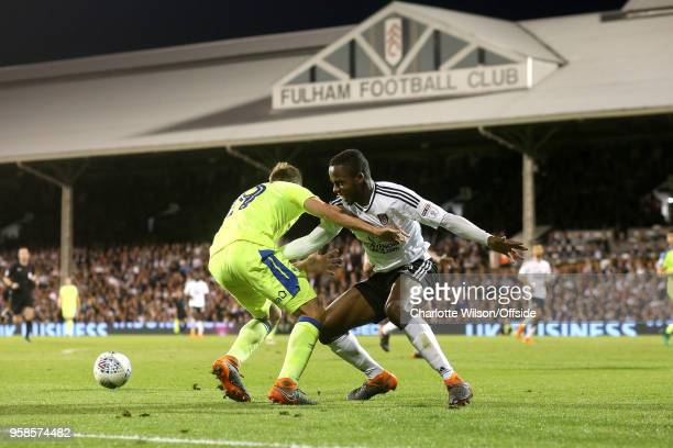 Andreas Weimann of Derby and Ryan Sessegnon of Fulham battle for the ball during the Sky Bet Championship Play Off Semi FinalSecond Leg match between...