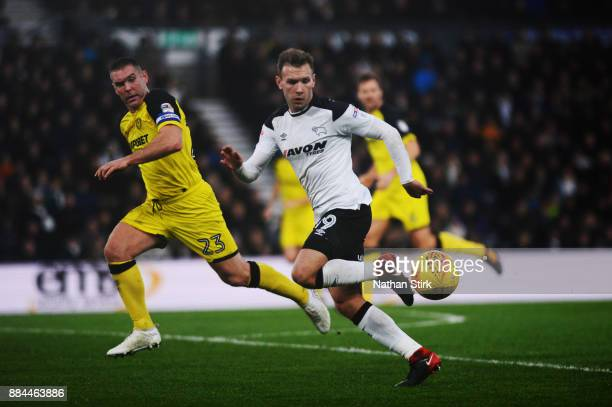 Andreas Weimann of Derby County and Jake Buxton of Burton Albion in action during the Sky Bet Championship match between Derby County and Burton...