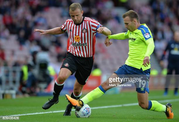 Andreas Weimann of Derby County challenges Lee Cattermole of Sunderland during the Sky Bet Championship match between Sunderland and Derby County at...