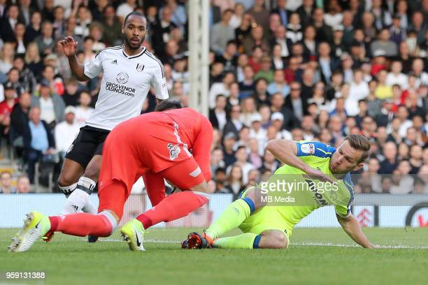 Andreas Weimann of Derby County slides into the Fulham keeper during the Sky Bet Championship Play Off Semi Final Second Leg on May 14 2018 at Craven...