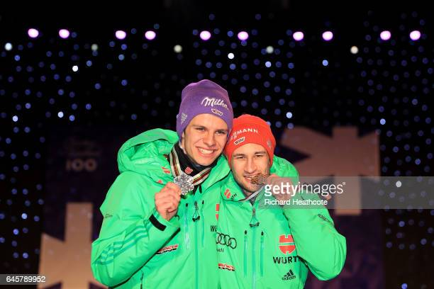 Andreas Wellinger and Markus Eisenbichler of Germany celebrate winning silver and bronze in the Men's Ski Jumping HS100 Final during the FIS Nordic...
