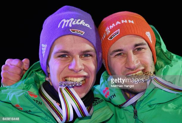 Andreas Wellinger of Germany and Markus Eisenbichler of Germany pose with their medals during the award ceremony after the Men's Ski Jumping HS100 at...