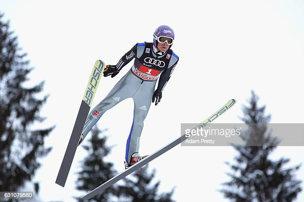 Andreas Wellinger of Germany competes at the trail round on Day 2 of the 65th Four Hills Tournament ski jumping event at PaulAusserleitnerSchanze on...