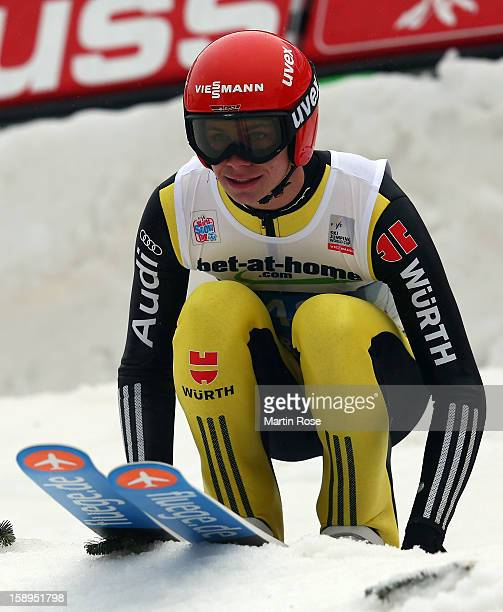 Andreas Wellinger of Germany reacts during the final round for the FIS Ski Jumping World Cup event of the 61st Four Hills ski jumping tournament at...