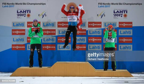 Andreas Wellinger of Germany Stefan Kraft of Austria and Markus Eisenbichler of Germany celebrate on the podium after the Men's Ski Jumping HS100 at...