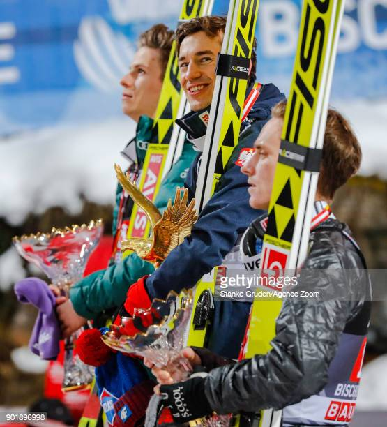 Andreas Wellinger of Germany takes 2nd place in the overall standings Kamil Stoch of Poland takes 1st place Anders Fannemel of Norway takes 3rd place...