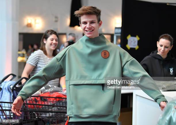 Andreas Wellinger tries on a sweatshirt during the 2018 PyeongChang Olympic Games German Team kit handover at Postpalast on January 22 2018 in Munich...