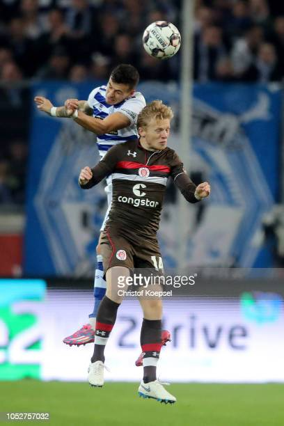 Andreas Wiegel of Duisburg jumps for the ball with Mats Moeller Daehli of St Pauli during the Second Bundesliga match between MSV Duisburg and FC St...