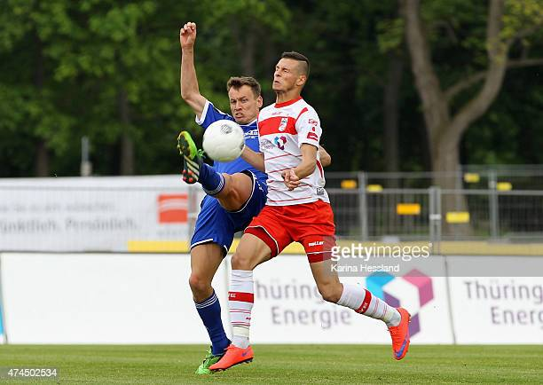 Andreas Wiegel of Erfurt is challenged by Benjamin Schwarz of Unterhaching during the Third League match between FC Rot Weiss Erfurt and SpVgg...