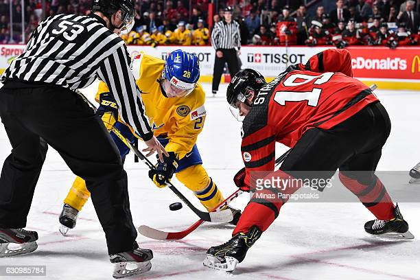 Andreas Wingerli of Team Sweden and Dylan Strome of Team Canada faceoff during the 2017 IIHF World Junior Championship semifinal game at the Bell...