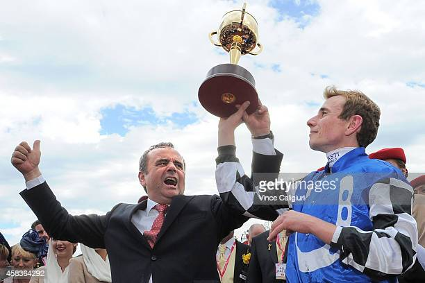 Andreas Wohler and jockey Ryan Moore pose with the trophy after Protectionist won Race 7 the Emirates Melbourne Cup on Melbourne Cup Day at...