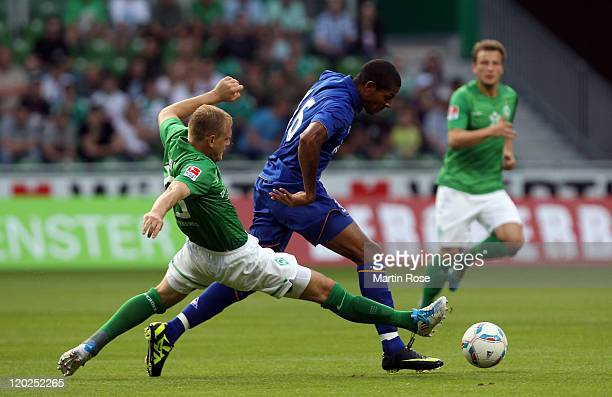 Andreas Wolf of Bremen and Jermaine Beckford of Everton battle for the ball during the pre season friendly match between SV Werder Bremen and Everton...