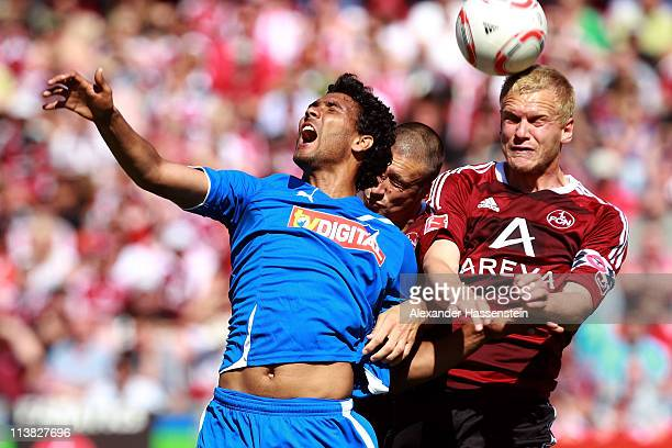 Andreas Wolf of Nuernberg and his team mate Timmy Simons battle for the ball with Marvin Compper of Hoffenheim during the Bundesliga match between 1...