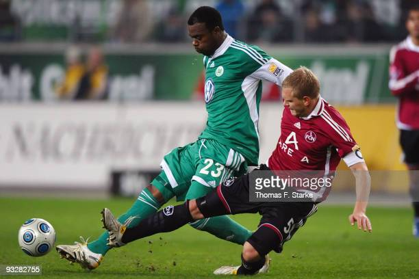Andreas Wolf of Nuernberg tackles Grafite of Wolfsburg during the Bundesliga match between VfL Wolfsburg and 1 FC Nuernberg at the Volkswagen Arena...