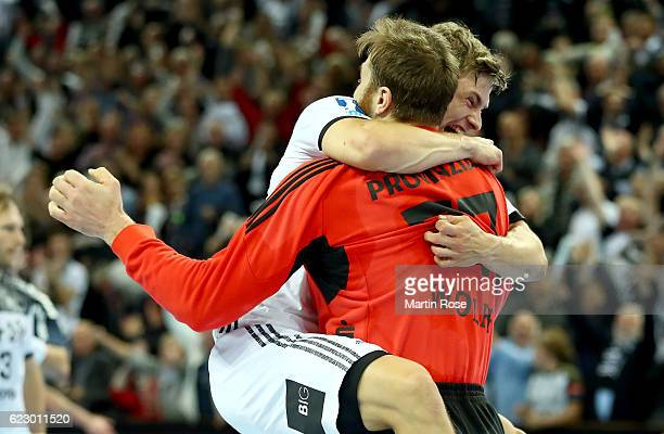 Andreas Wolff goalkeeper of Kiel celebrate with team mate Rune Dahmke after the DKB HBL Bundesliga match between THW KIEl and SG FlensburgHandewitt...