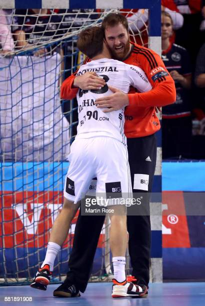 Andreas Wolff goaltender of Kiel celebrate with team mate Rune Dahmke after the Velux EHF Champions League match between SG Flensburg Handewitt and...