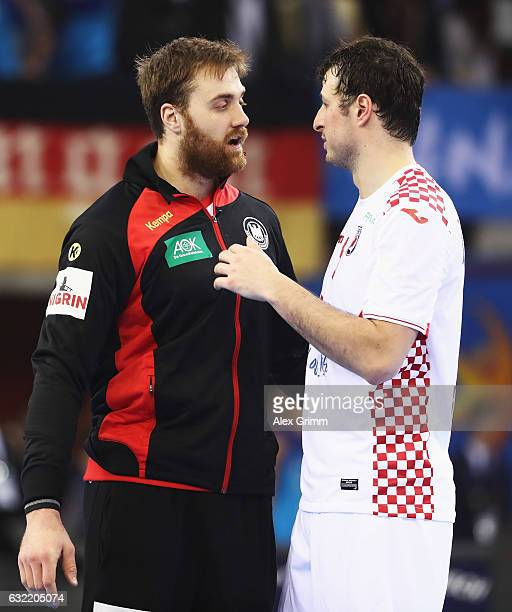 Andreas Wolff of Germany greets club teamate Domagoj Duvnjak of Croatia dafter the 25th IHF Men's World Championship 2017 match between Germany and...