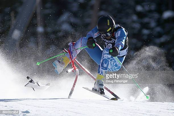 Andreas Zampa of Slovakia crashes through a gate as he skis the course during the first run of the giant slalom at the 2015 Audi FIS Ski World Cup on...