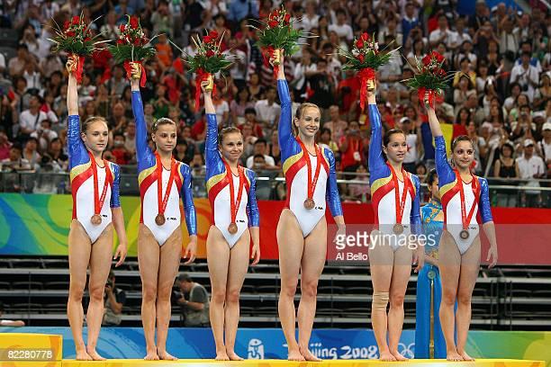 Andreea Acatrinei Gabriela Dragoi Andreea Grigore Sandra Izbasa Steliana Nistor and Anamaria Tamirjan of the Romania women's gymnastics team...