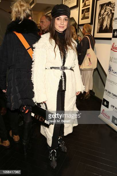 Andreea Cristea attends a private view of 'Beyond The Boundary' the first solo exhibition by former England cricketer and photographer Nick Compton...