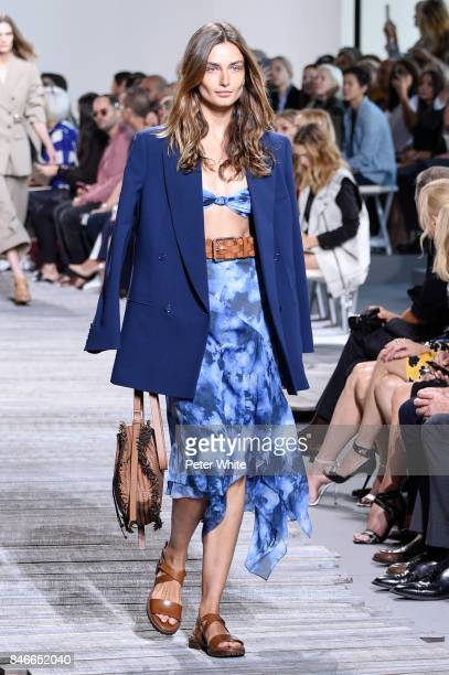 Andreea Diaconu walks the runway at the Michael Kors Ready to Wear Spring/Summer 2018 fashion show during New York Fashion Week at Spring Studios on...