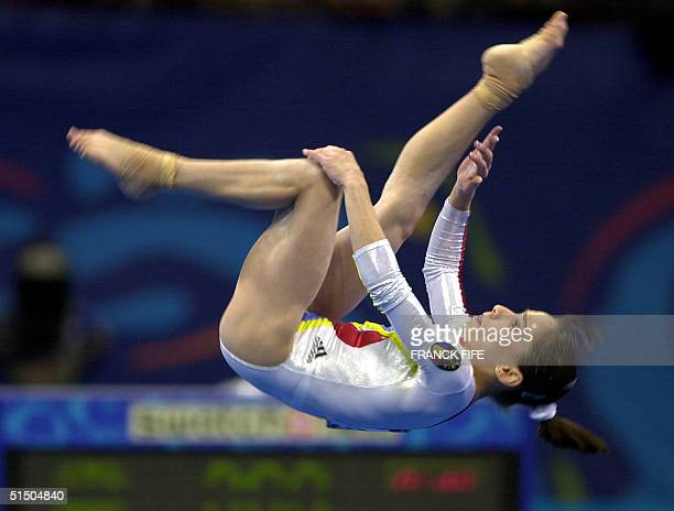 Andreea Raducan of Romania performs her floor exercise routine 17 September 2000 at the SuperDome during the women's gymnastics qualification at the...