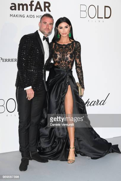 Andreea Sasu and fashion designer Phillipp Plein arrive at the amfAR Gala Cannes 2018 at Hotel du CapEdenRoc on May 17 2018 in Cap d'Antibes France