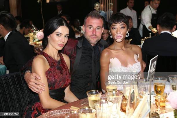 Andreea Sasu Philipp Plein and Winnie Harlow attend the amfAR Gala Cannes 2017 at Hotel du CapEdenRoc on May 25 2017 in Cap d'Antibes France