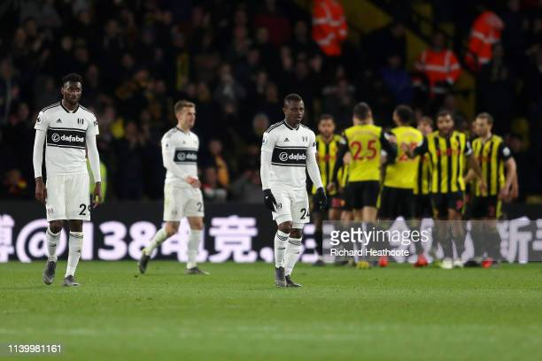 AndreFrank Zambo Anguissa and Jean Michael Seri of Fulham look dejected after their team concede during the Premier League match between Watford FC...