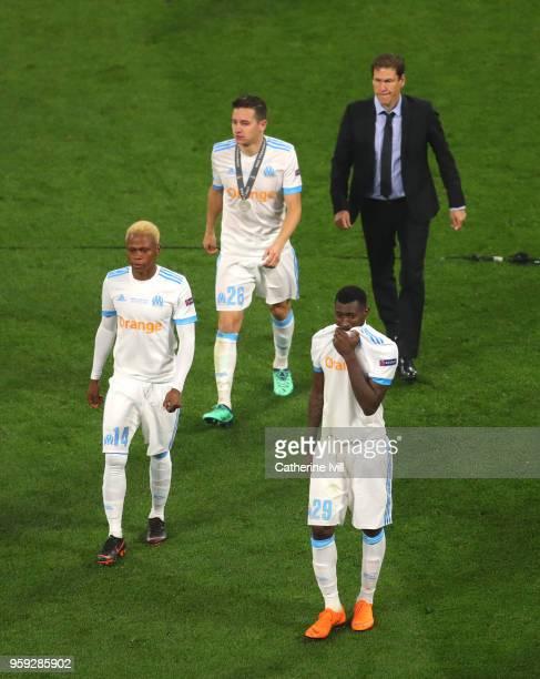 AndreFrank Zambo Anguissa Jordan Amavi Florian Thauvin of Marseille and Rudi Garcia head coach of Marseille look dejected following the UEFA Europa...
