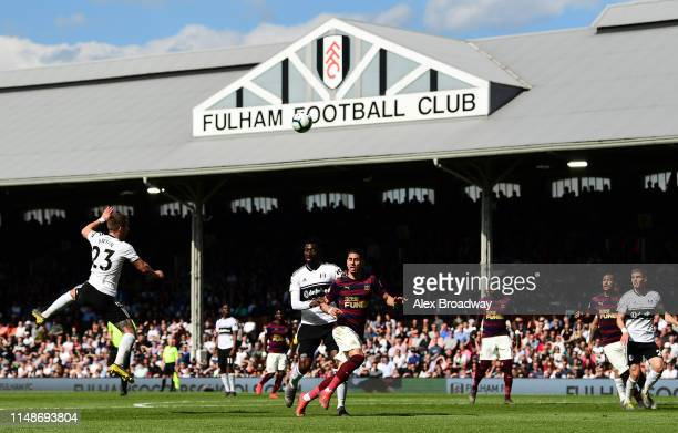 AndreFrank Zambo Anguissa of Fulham and Ayoze Perez of Newcastle United contest the ball during the Premier League match between Fulham FC and...