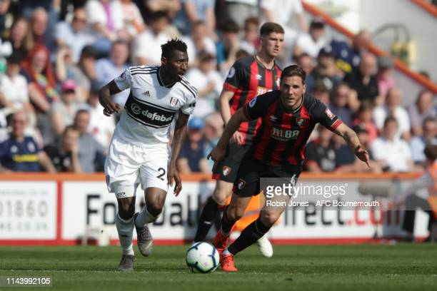 AndreFrank Zambo Anguissa of Fulham and Dan Gosling of Bournemouth during the Premier League match between AFC Bournemouth and Fulham FC at Vitality...