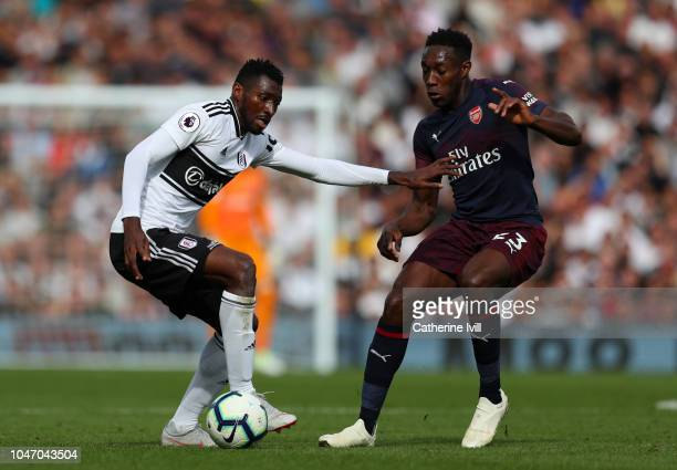 AndreFrank Zambo Anguissa of Fulham battles for possession with Danny Welbeck of Arsenal during the Premier League match between Fulham FC and...