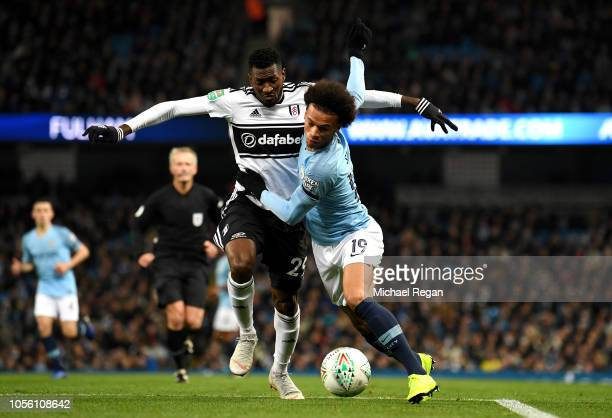AndreFrank Zambo Anguissa of Fulham battles for possession with Leroy Sane of Manchester City during the Carabao Cup Fourth Round match between...