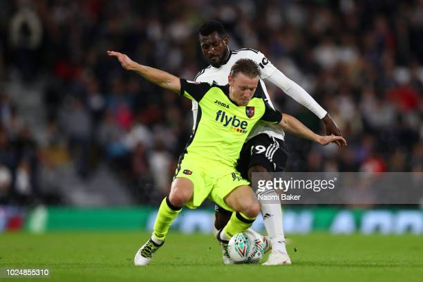 AndreFrank Zambo Anguissa of Fulham battles for possession with Matt Jay of Exeter City during the Carabao Cup Second Round match between Fulham and...