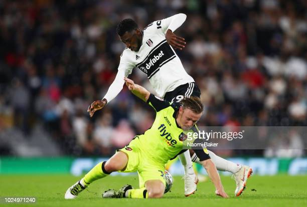 AndreFrank Zambo Anguissa of Fulham battles for possession with Matt Jay of Exeter during the Carabao Cup Second Round match between Fulham and...