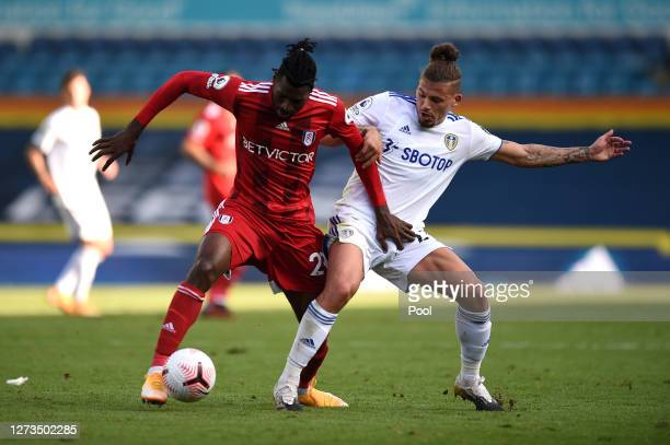 AndreFrank Zambo Anguissa of Fulham battles for possession with Kalvin Phillips of Leeds United during the Premier League match between Leeds United...