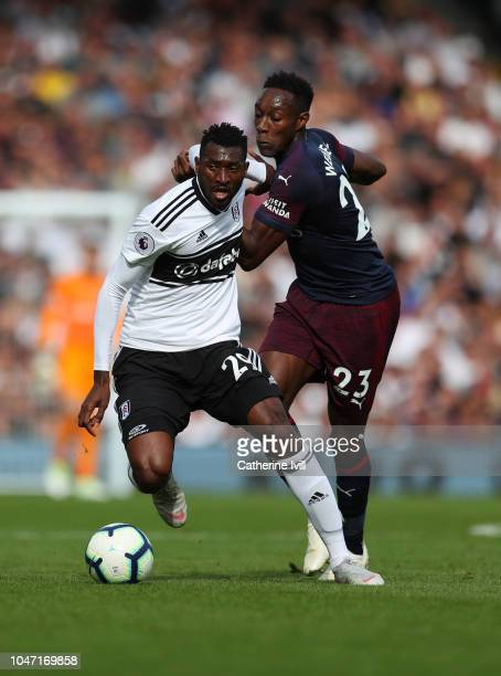 AndreFrank Zambo Anguissa of Fulham battles with Danny Welbeck of Arsenal during the Premier League match between Fulham FC and Arsenal FC at Craven...