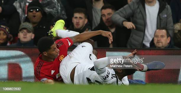 AndreFrank Zambo Anguissa of Fulham FC clashes with Marcus Rashford of Manchester United and is sent off during the Premier League match between...