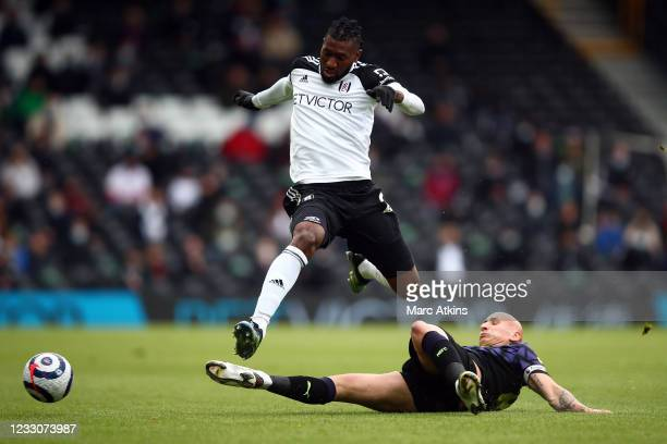 Andre-Frank Zambo Anguissa of Fulham in action with Jonjo Shelvey of Newcastle United during the Premier League match between Fulham and Newcastle...
