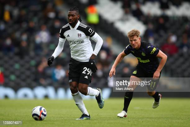 Andre-Frank Zambo Anguissa of Fulham in action with Matt Ritchie of Newcastle United during the Premier League match between Fulham and Newcastle...