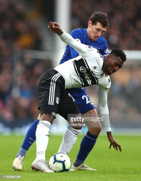 AndreFrank Zambo Anguissa of Fulham is tackled by Andreas Christiansen of Chelsea during the Premier League match between Fulham FC and Chelsea FC at...