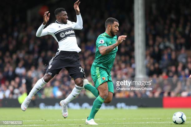 AndreFrank Zambo Anguissa of Fulham jumps back as Troy Deeney of Watford gets away from him during the Premier League match between Fulham FC and...