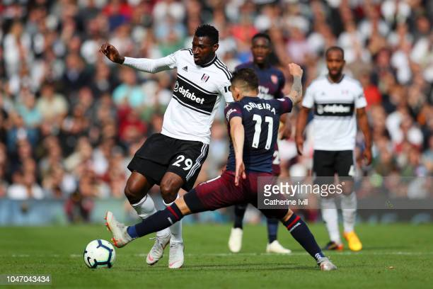 AndreFrank Zambo Anguissa of Fulham passes the ball under pressure from Lucas Torreira of Arsenal during the Premier League match between Fulham FC...
