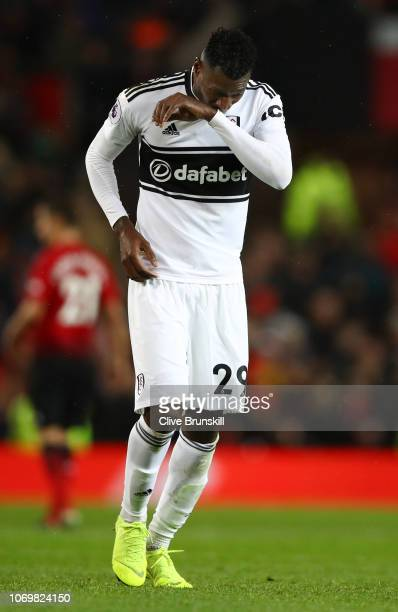 AndreFrank Zambo Anguissa of Fulham reacts after receiving a red card during the Premier League match between Manchester United and Fulham FC at Old...